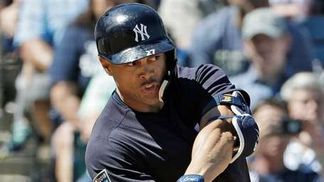 The Yankees' Giancarlo Stanton grounds out against Pirates