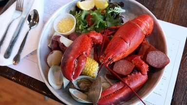 "The ""lobstah pot"" arrives with savory kielbasa and"