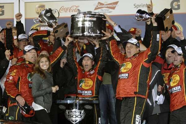 Jamie McMurray, center, with crew, celebrates in victory