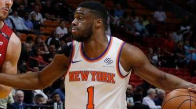 Knicks guard Emmanuel Mudiay tries to get past
