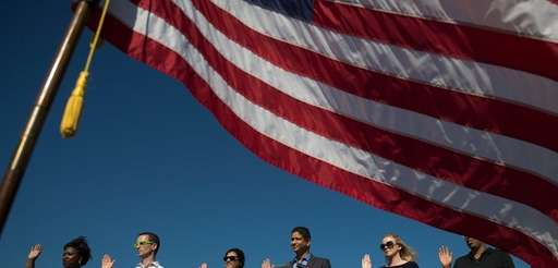 An American flag billows in the wind as