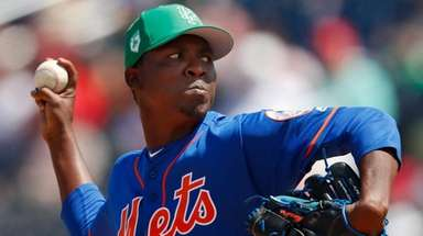 Rafael Montero works against the Nationals in a