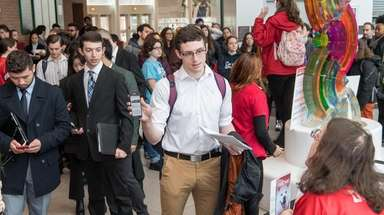 Students register at a job fair hosted by