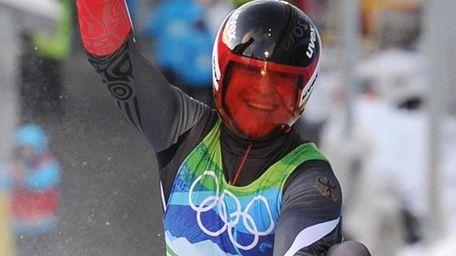 Gold medal winner Germany's Felix Loch reacts after