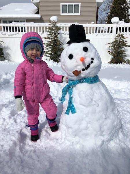 Maia and her Snowman..