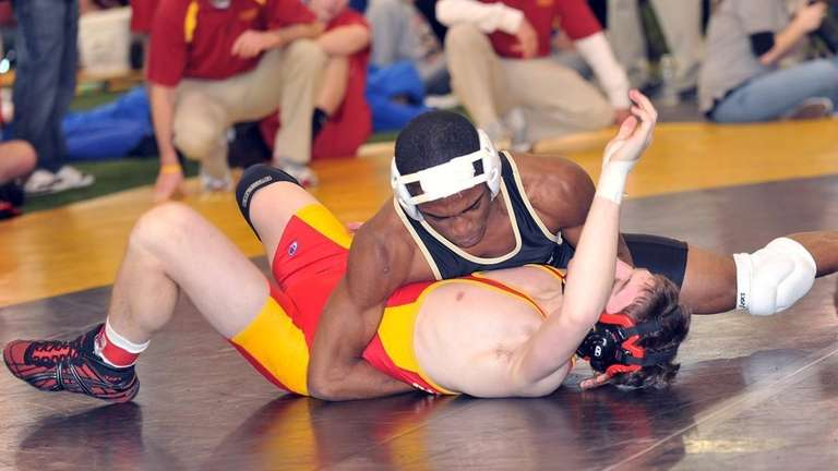 St. Anthony's Jamel Hudson, top, pins Mike Jones