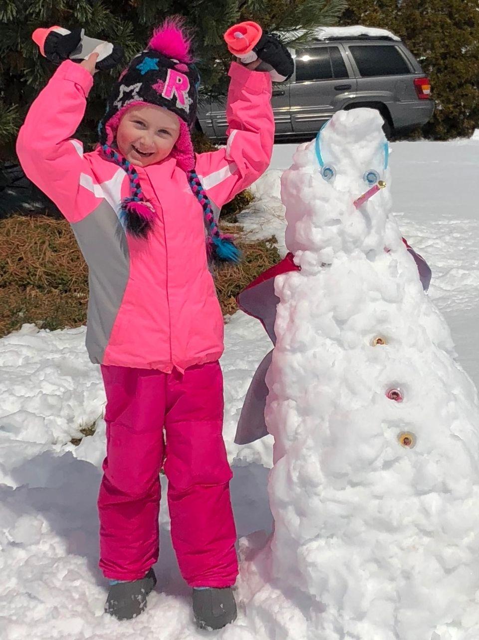 Reilly Fletcher, 5 - Building a snowman on