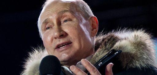 Russian President Vladimir Putin speaks to supporters in