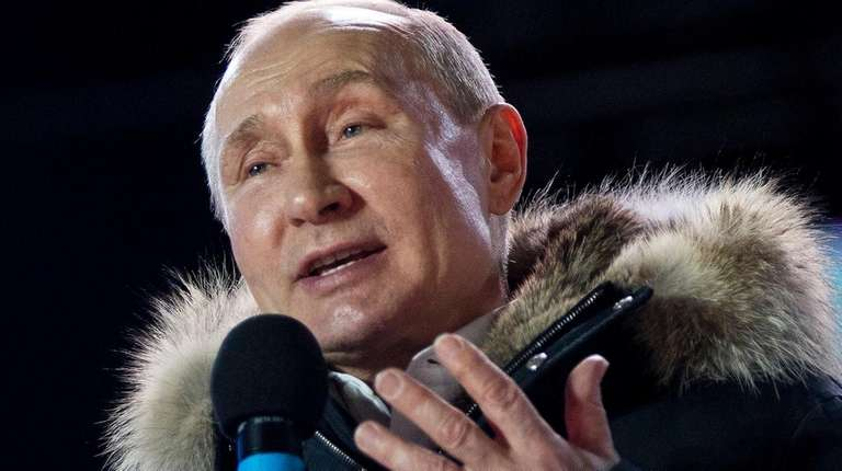 Russian President Vladimir Putin speaks to supporters in