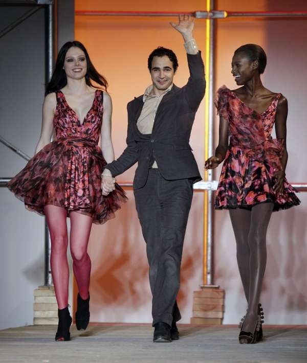 Designer Zac Posen acknowledges the audience's applause after