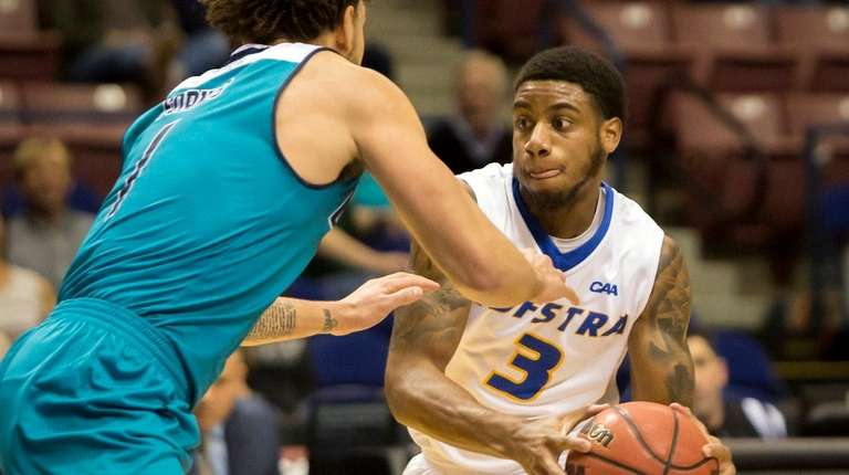 Hofstra guard Justin Wright-Foreman (3) looks to pass