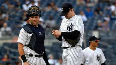 Catcher Austin Romine and pitcher Jordan Montgomery on