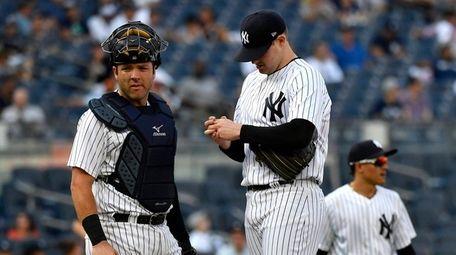 Catcher Austin Romine and pitcher Jordan Montgomery on