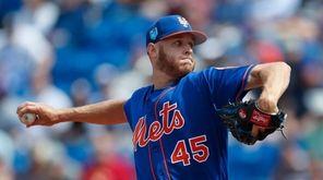 Mets starting pitcher Zack Wheeler (45) works in