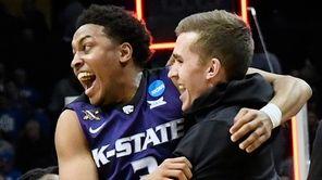 Kansas State guard Kamau Stokes celebrates a win