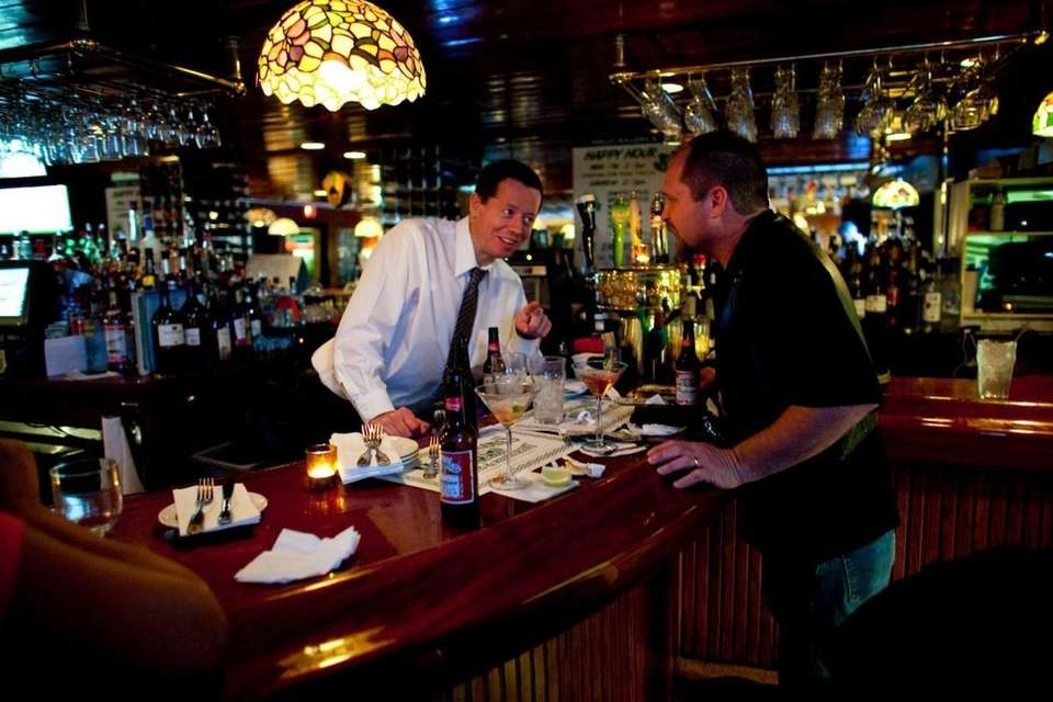 A patron chats with the bartender at Molly