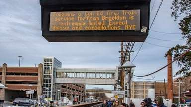 An electronic message board at the Mineola LIRR