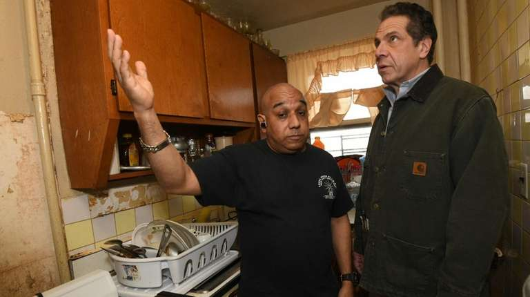 Gov. Andrew Cuomo tours the Forest Houses in