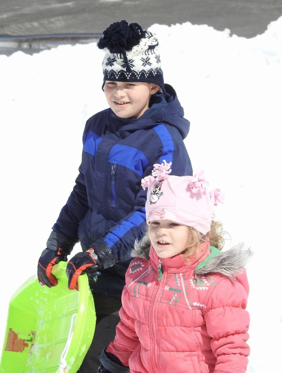Rayan & Lauren enjoying playing in the snow.
