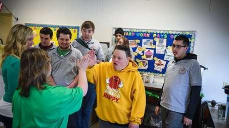 Keith Caputo interacts with students during a visit