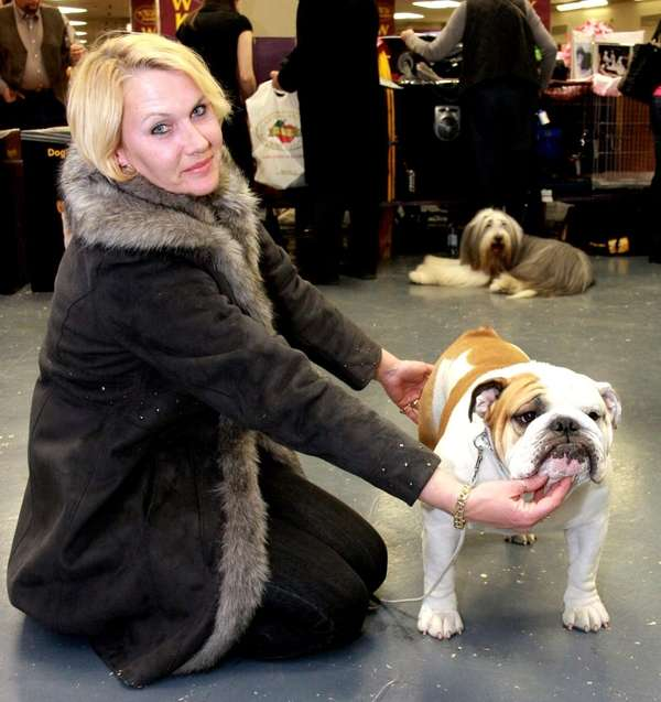 Munch the bulldog poses with owner Deirdre McKell,