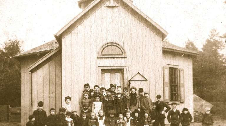 Schoolchildren pose in front of the Modern Times