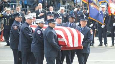The coffin of FDNY EMT Yadira Arroyo is