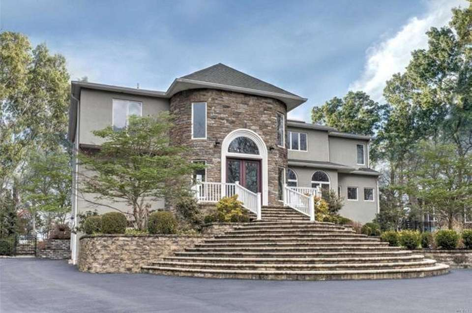 This Hampton Bays contemporary features four bedrooms and
