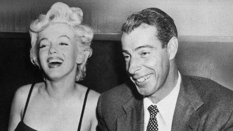 Marilyn Monroe, left, laughs with her husband, Joe