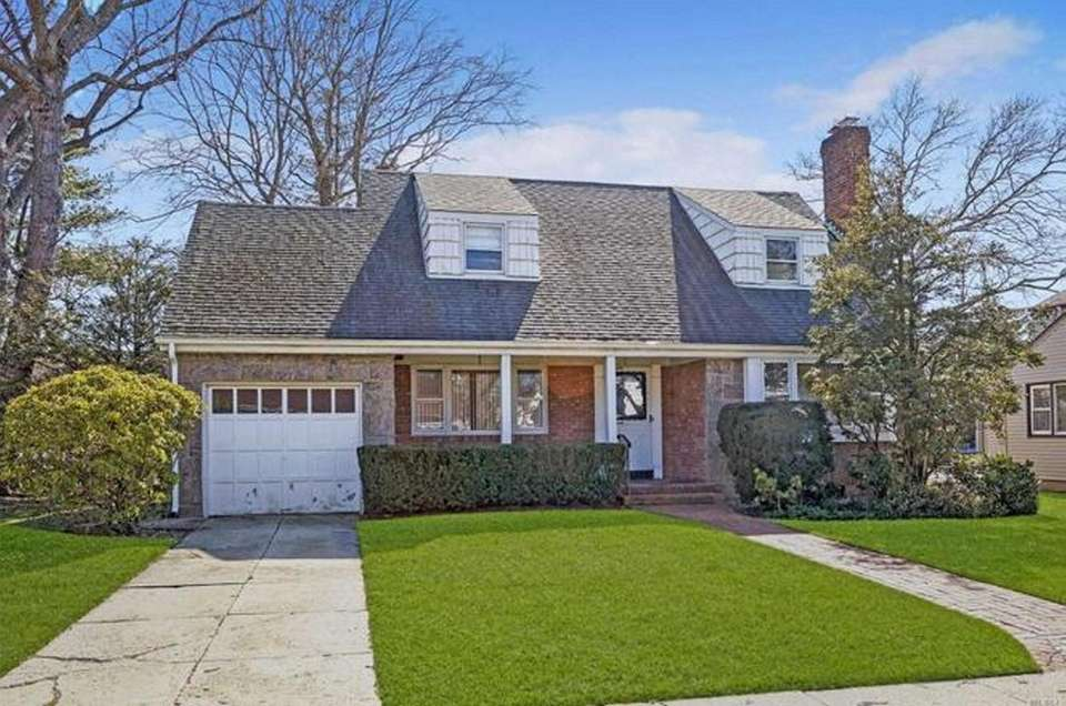 This Rockville Centre Cape features four bedrooms and
