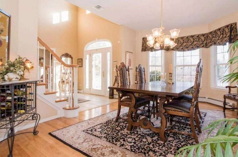 The two-story entry foyer in this Stony Brook