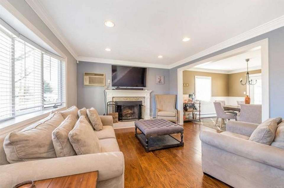 Featured in this renovated Levittown expanded-Cape is a