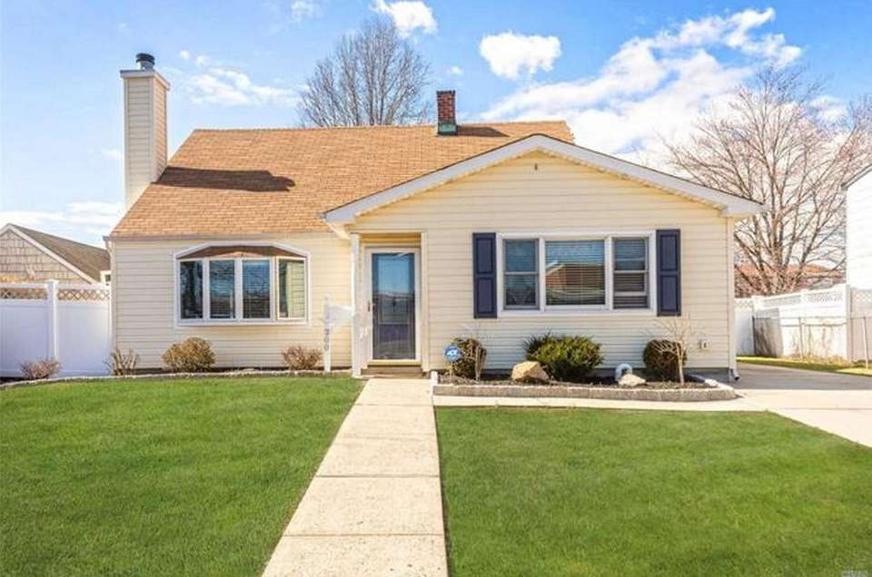 This Levittown expanded-Cape includes three bedrooms and one
