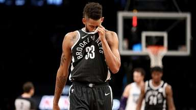 Allen Crabbe of the Nets reacts late in