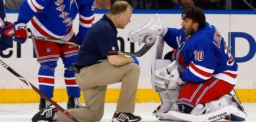 Henrik Lundqvist of the Rangers is checked out