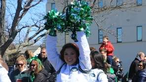 Cheerleaders from the New York Jets marched in
