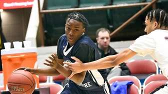 Lawrence Woodmere Academy's Kasaun Thomas (3) moves the