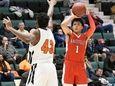 Amityville's Joshua Serrano puts up a shot against