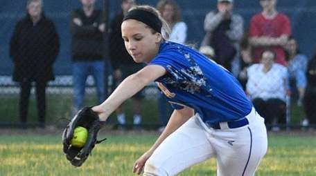 East Meadow's Jenna Laird backhands the ball at