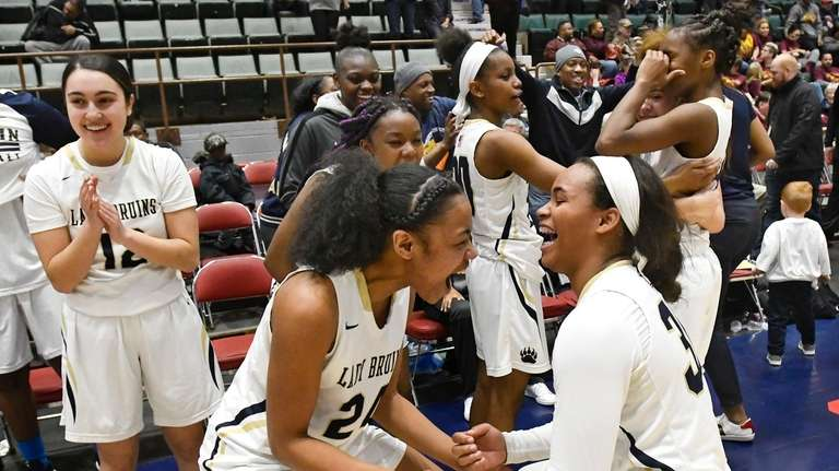 Baldwin players celebrate a 58-49 win against Christ