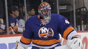 Islanders goaltender Jaroslav Halak ontrols the loose puck