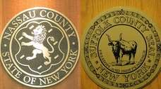 The seals of Nassau and Suffolk counties. Suffolk