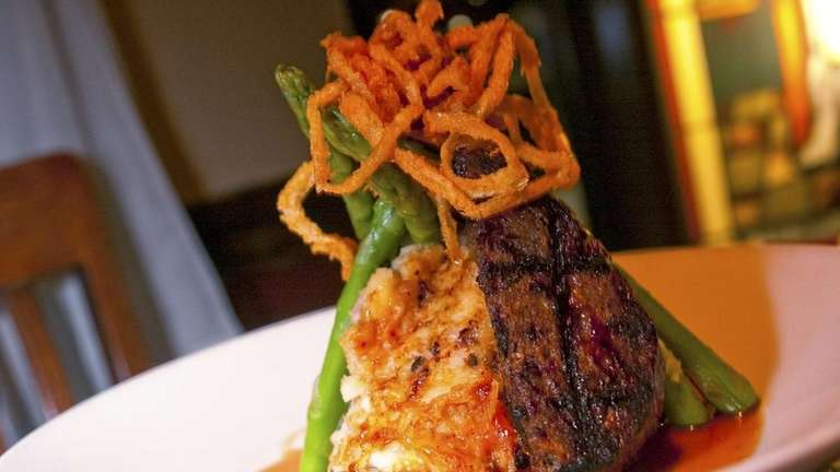 The grilled meatloaf with mashed potatoes, asparagus, onion