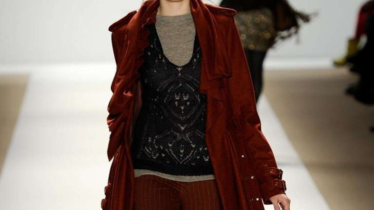 A model walks the runway at the Nanette