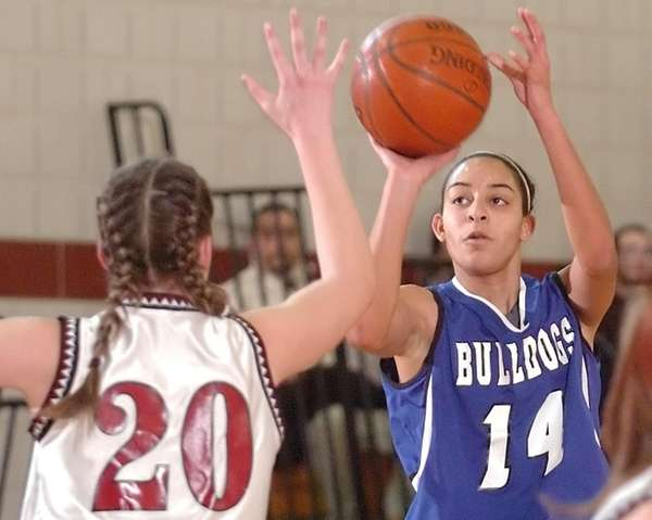 North Babylon's Bria Hartley puts up a shot