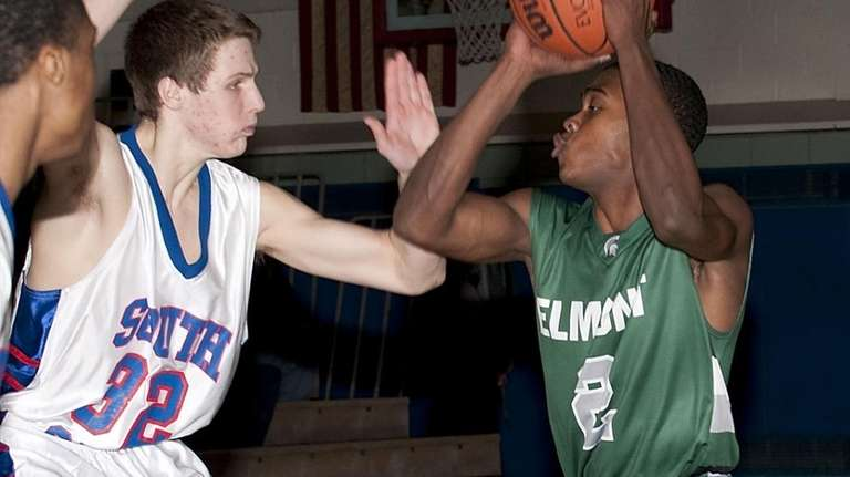 South Side's Ryan Spadafora guards as Elmont's Dominique