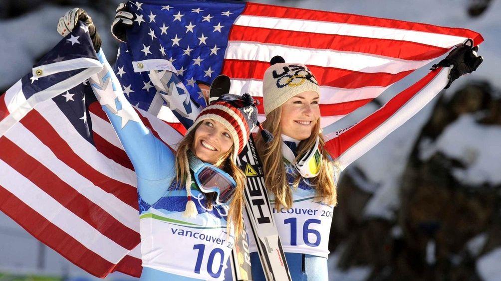 USA's Julia Mancuso, left, and Lindsey Vonn hold