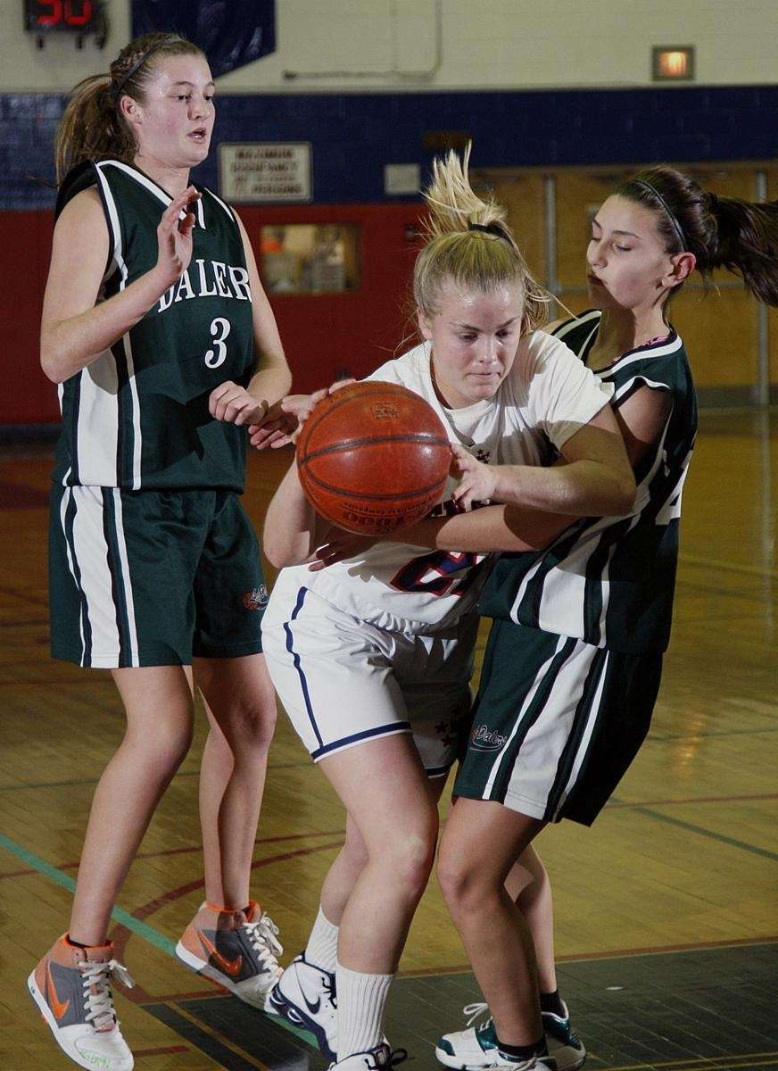 MacArthur's Christine Page (21) drives between Farmingdale's Kyra