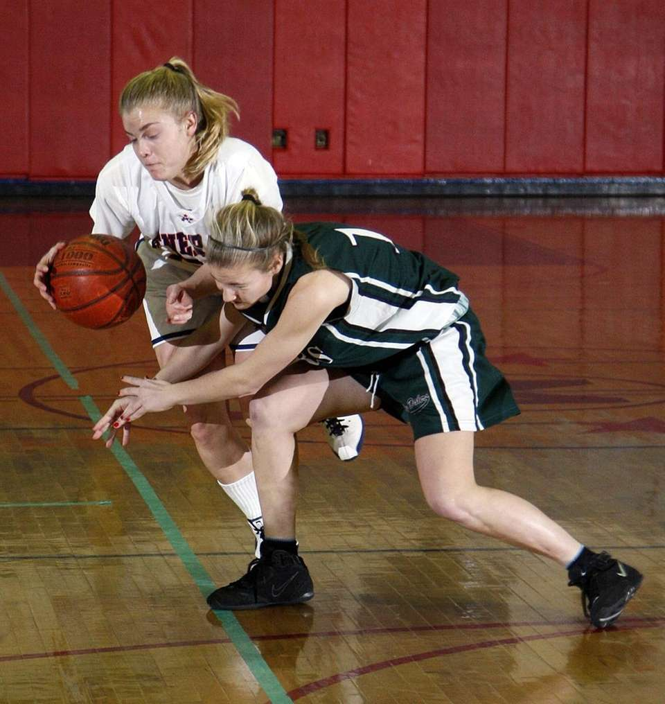 MacArthur's Christine Page (21) avoids the steal attempt