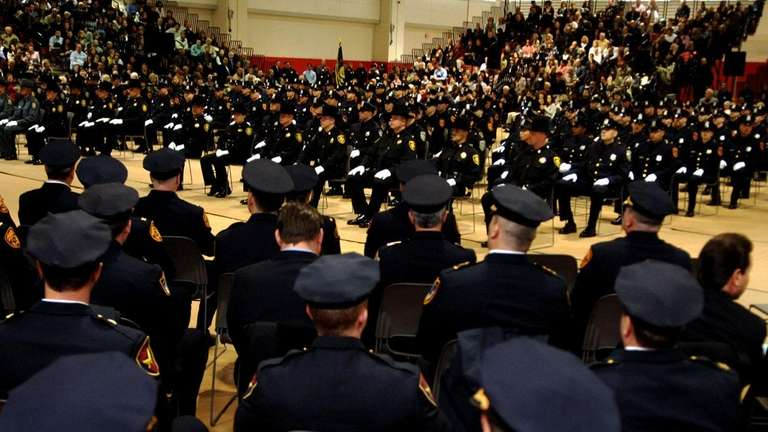 A new class of Suffolk police officers graduate.